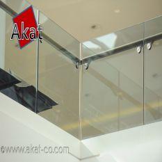 نرده شیشه ای بالکن با هندریل استیل کنار شیشه